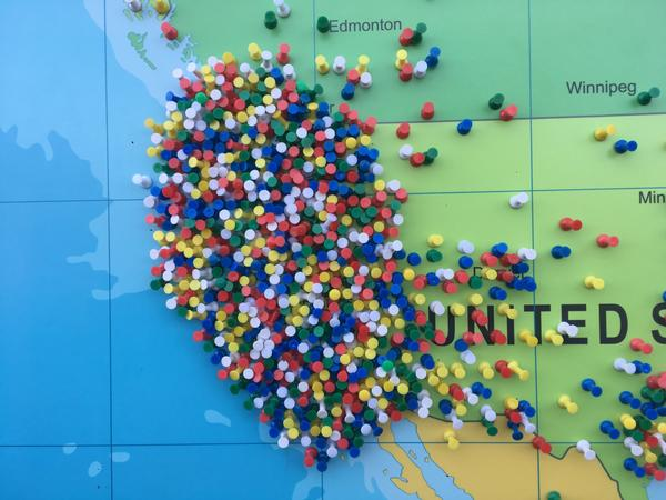 Pins on a map of the world show where Oregon Solarfest visitors traveled from. (Russ Mitchell / Los Angeles Times)