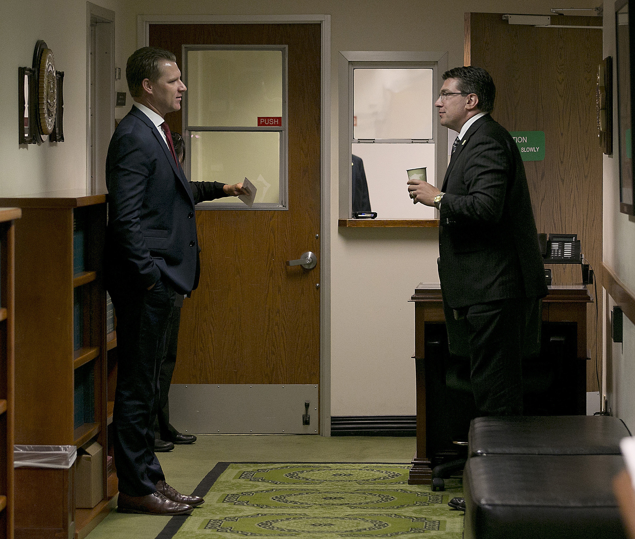 Assembly Republican Leader Chad Mayes, left, talks with Assemblyman Jay Obernolte, who has expressed interest in replacing Mayes, on Monday in the Capitol. (Rich Pedroncelli / Associated Press)