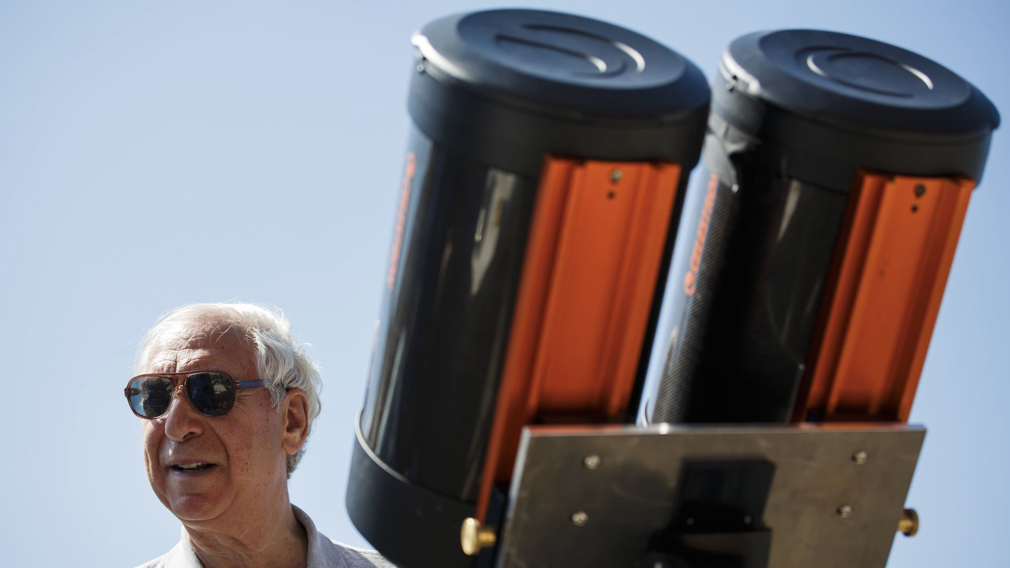 Jay Pasachoff supervises a large telescope being set up to observe the solar eclipse at Willamette University in Oregon.