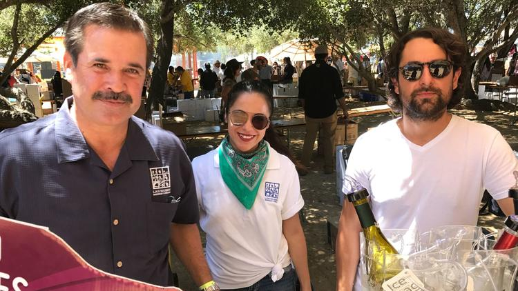 Vintner Victor Segura, from left, with Gilda Diaz and Daniel Benitez of Las Nubes Winery attend the