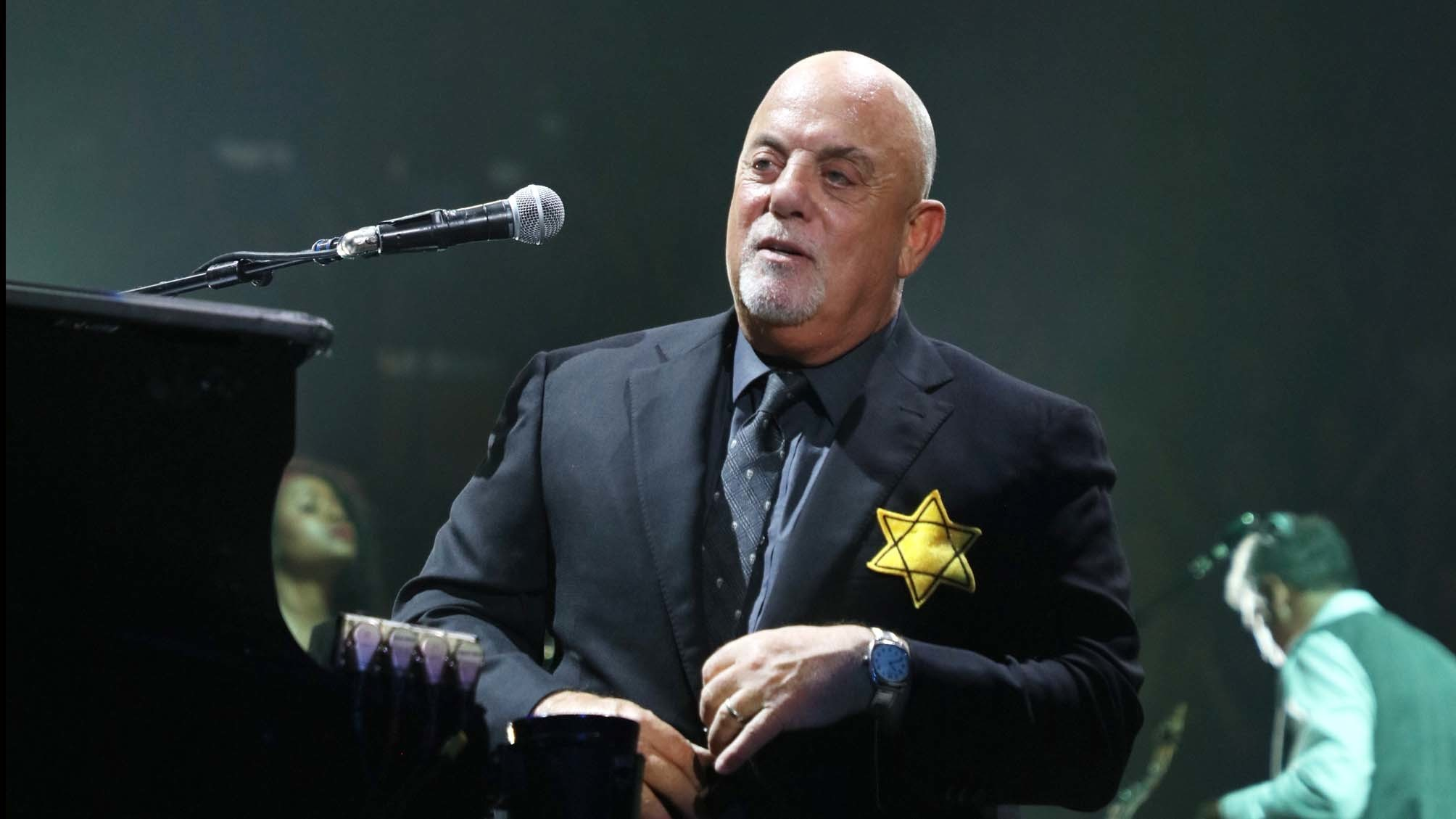 Billy Joel wears a jacket with a Star of David badge on the front — there was an identical badge on the back — at Madison Square Garden on Monday. (Myrna M. Suarez / Getty Images)