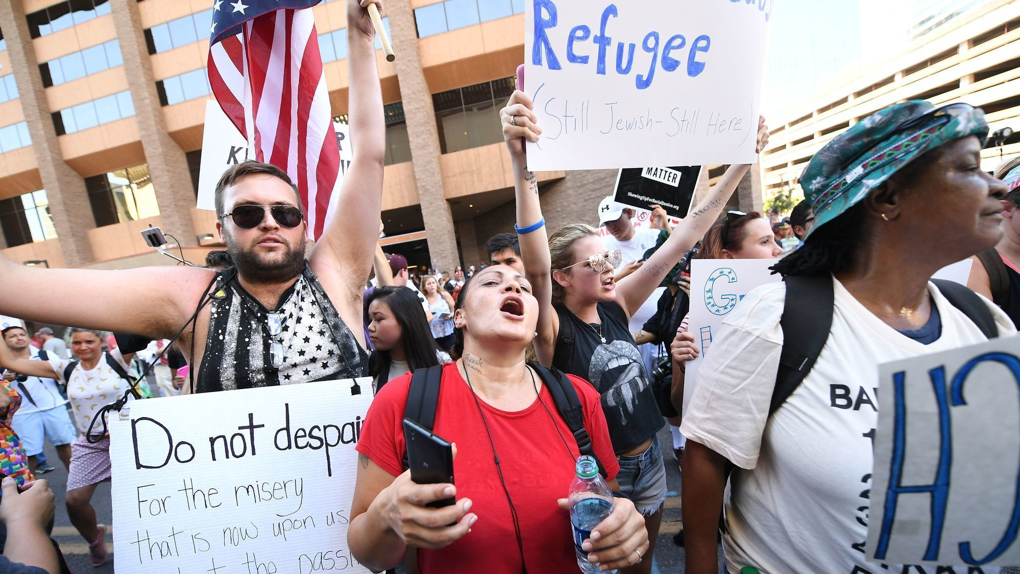 Thousands of protesters descend on Phoenix ahead of President Trump's rally