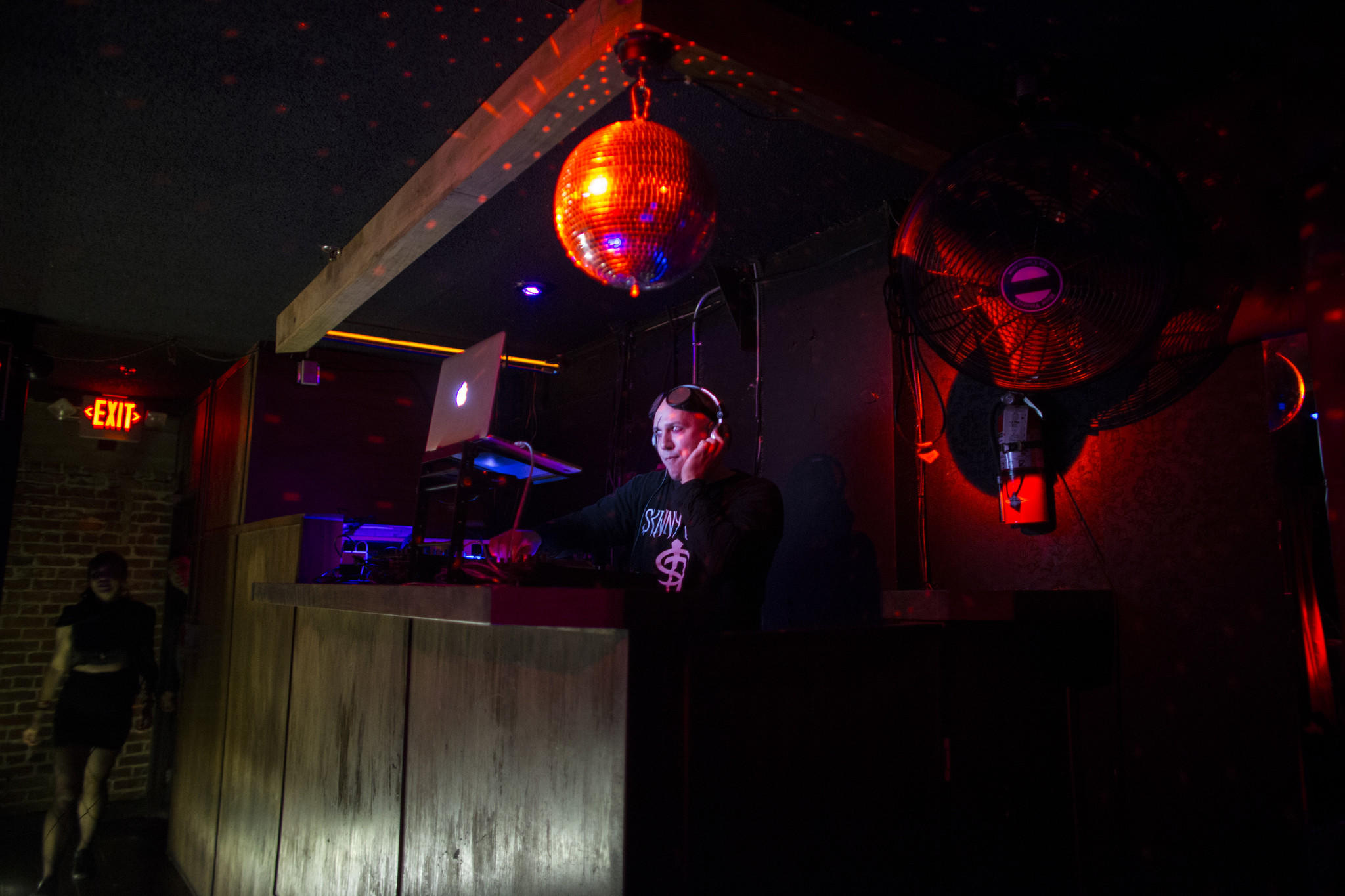 A DJ spins records in between performances on the top level at Los Globos. (Gina Ferazzi / Los Angeles Times)