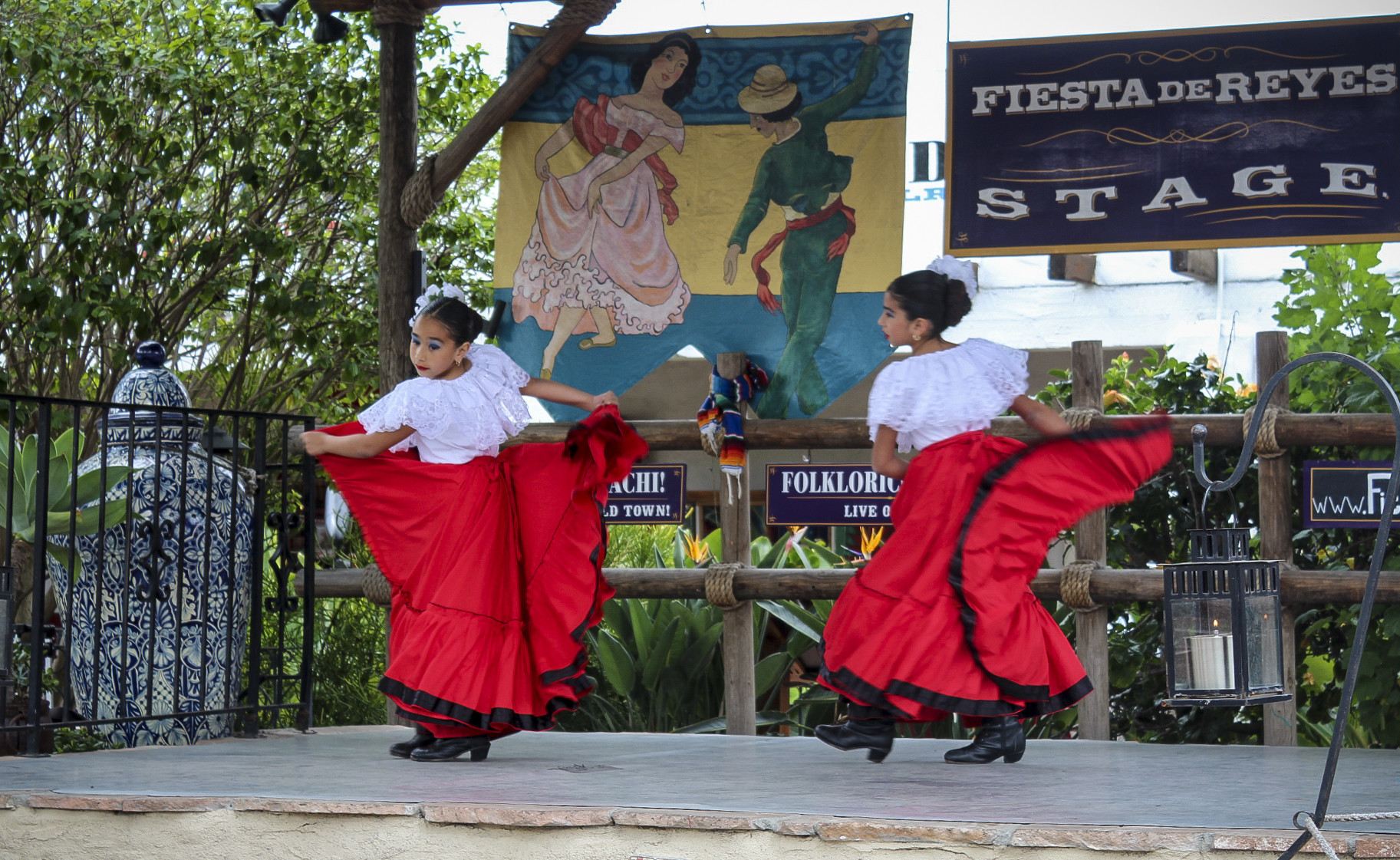 Young folklorico dancers perform in the courtyard of Fiesta de Reyes in San Diego's Old Town. Tacos and churros are just steps away.