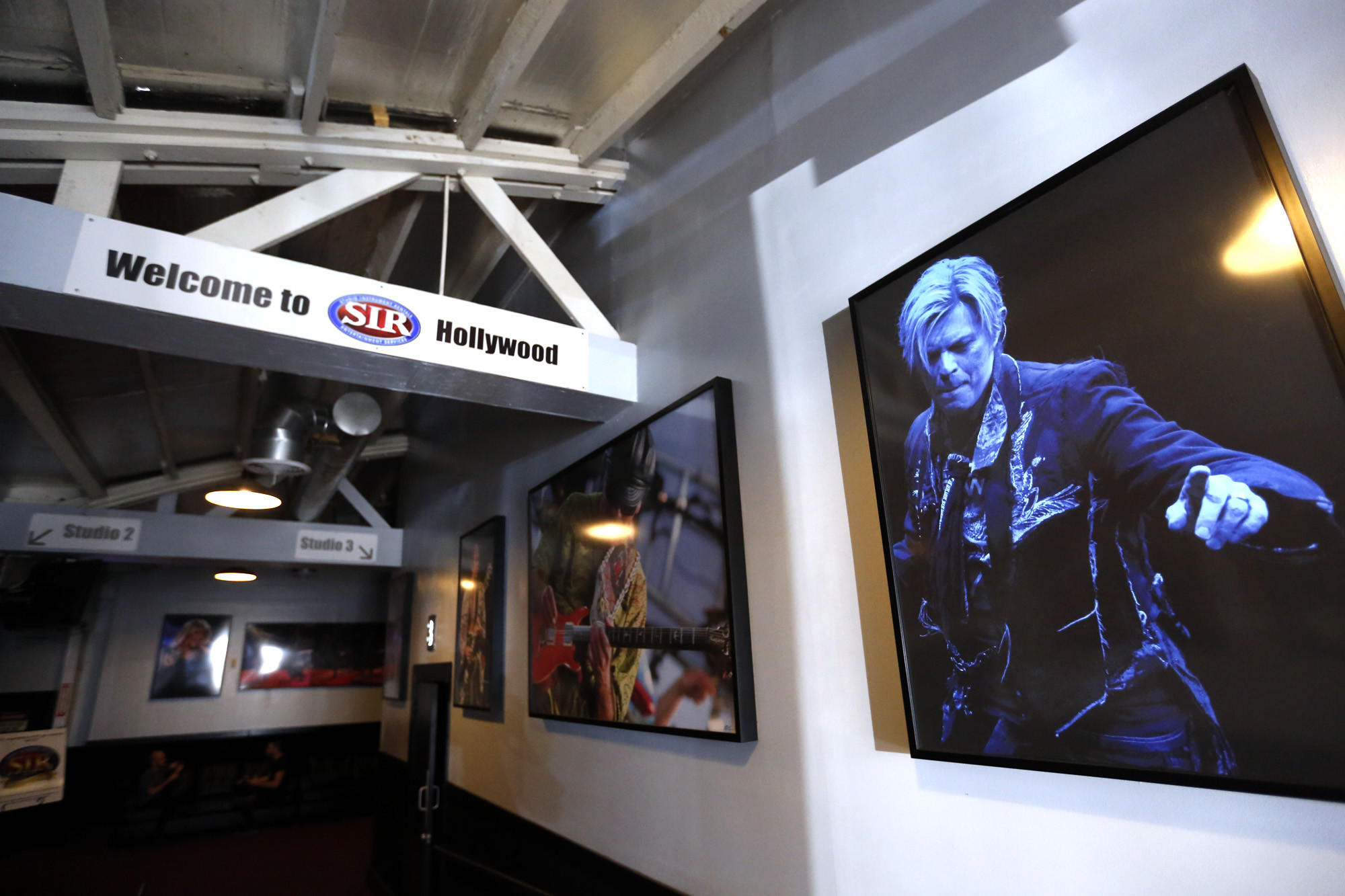 A gallery of photographs welcoming visitors to Studio Instrument Rentals includes the late David Bowie. (Genaro Molina / Los Angeles Times)