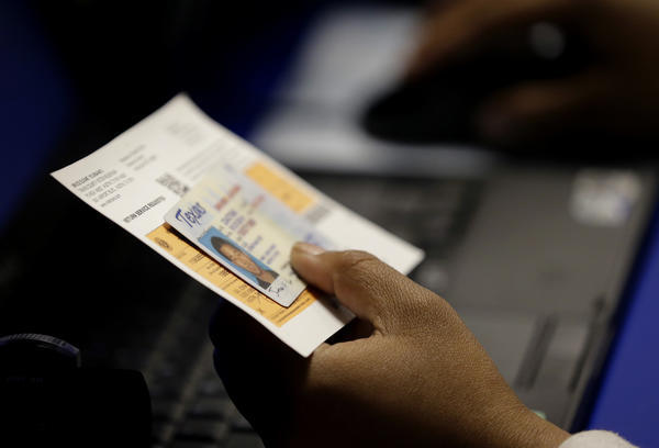 Federal judge tosses out Texas voter ID law supported by Trump administration