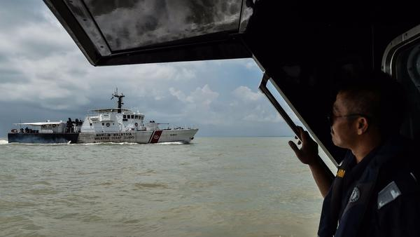 Body found by Malaysia is not the remains of one of the missing U.S. sailors, Navy says
