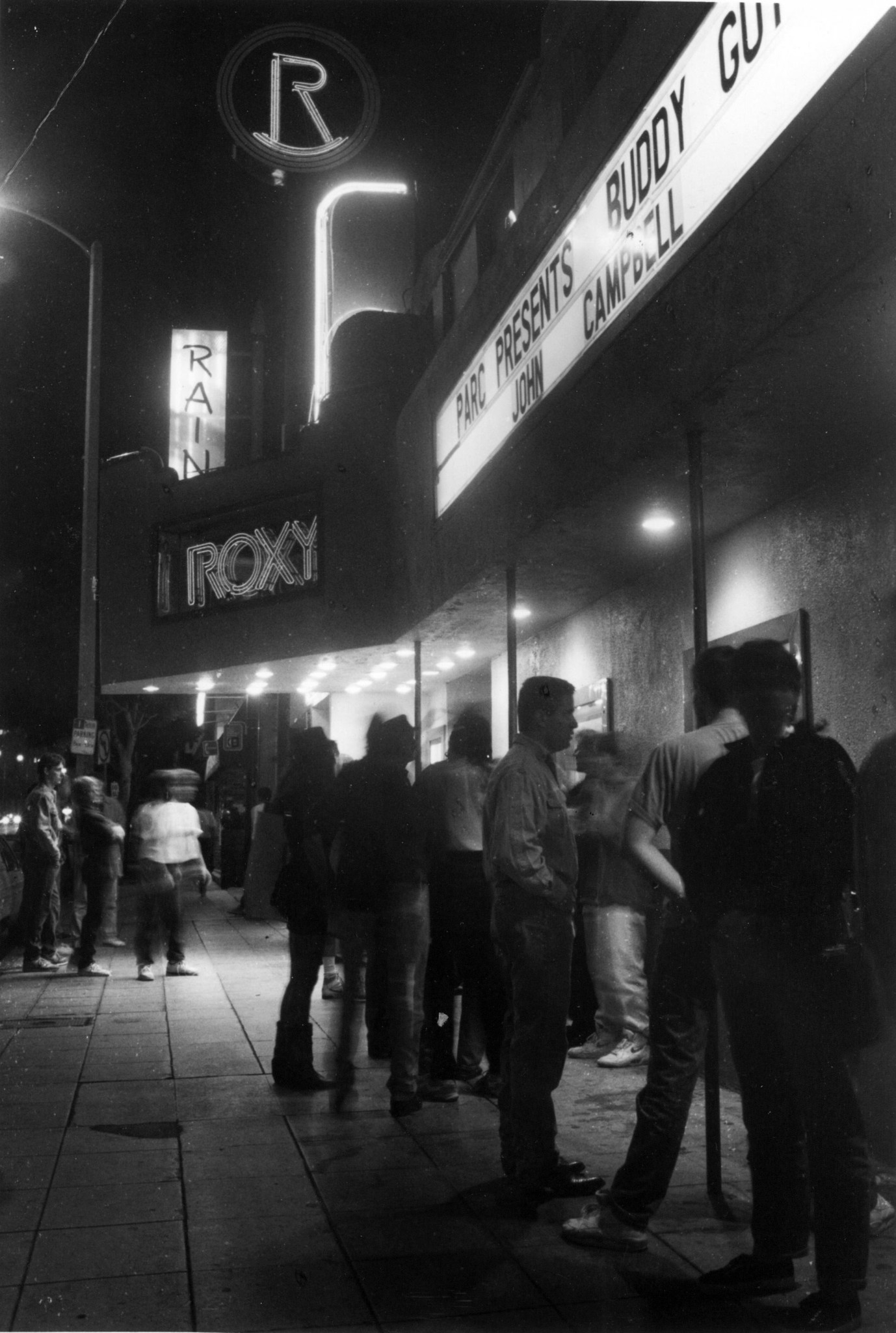 People gather outside the Roxy Theater in 1991.