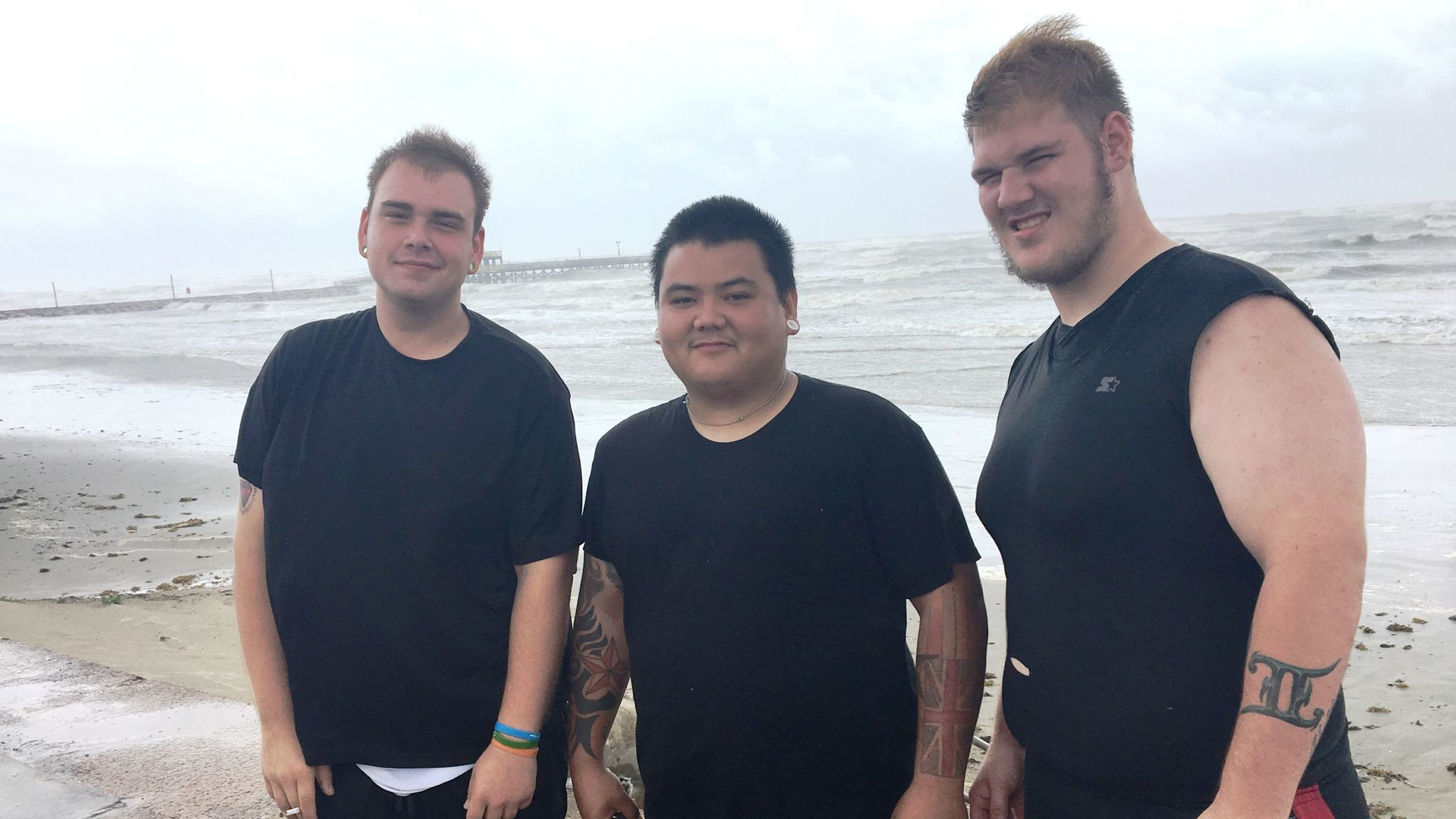 William Mead, Branden Castillo and James Hibberts contemplate skimboarding in Galveston.