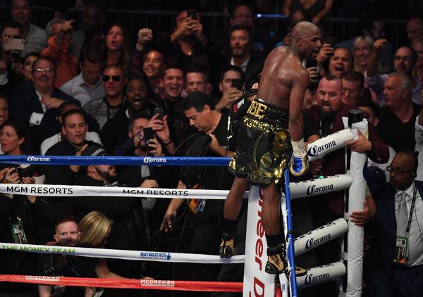 Floyd Mayweather Jr. celebrates his victory over Conor McGregor after their super-welterweight fight. (Ethan Miller / Getty Images)
