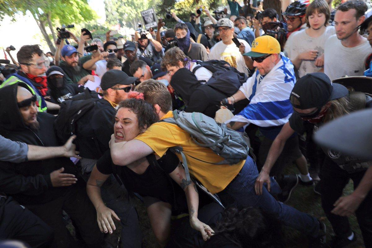 One of several fights that broke out Sunday. (Marcus Yam / Los Angeles Times)
