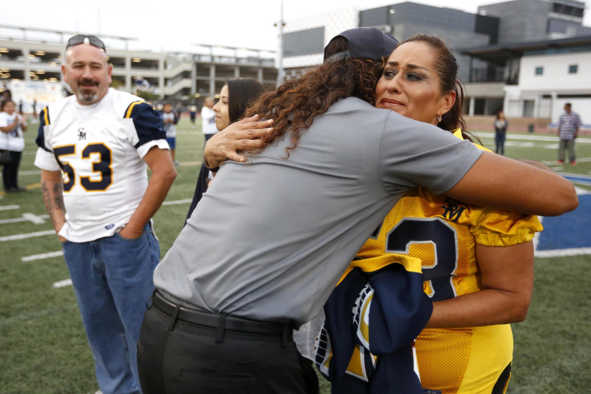 Coach Lambert hugs Lourdes Castillo