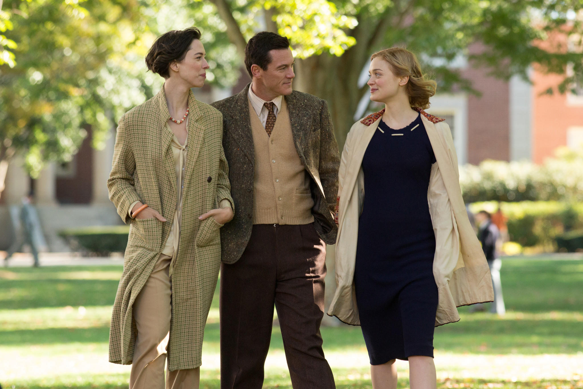 """From left: Rebecca Hall, Luke Evans and Bella Heathcote in """"Professor Marston and the Wonder Women."""" (Claire Folger /  Annapurna Pictures)"""