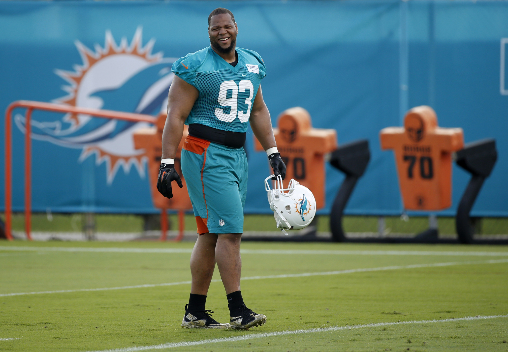 Dolphins 305 pound dt ndamukong suh showcases his leg as a kicker dolphins 305 pound dt ndamukong suh showcases his leg as a kicker during practice sun sentinel voltagebd Images