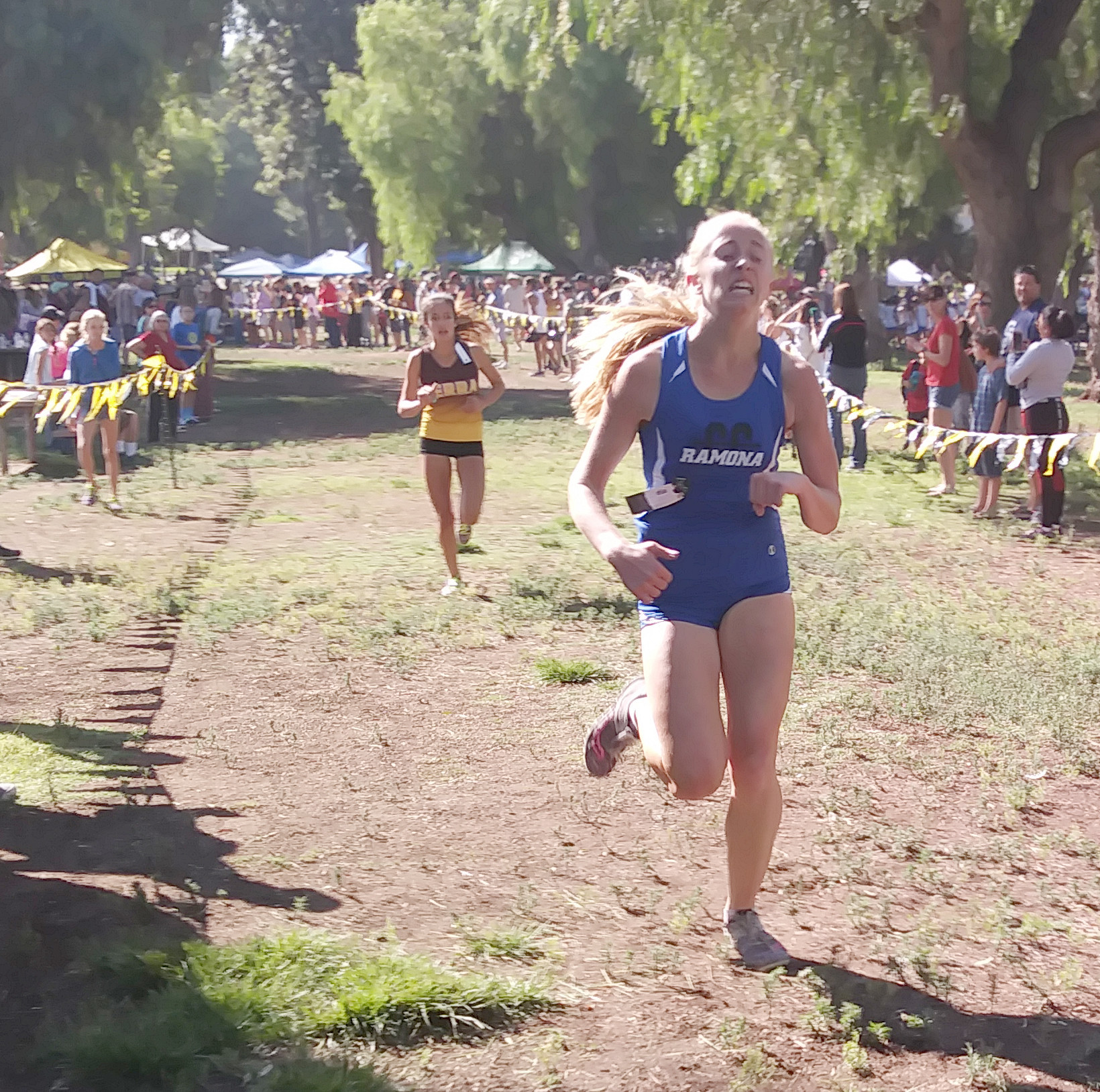 Amy Brown pulls away from Alyss Ruiz from Serra High School to finish second.