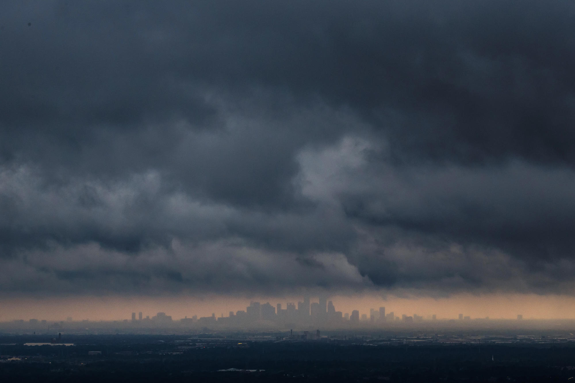 Storm clouds over Houston skyline.