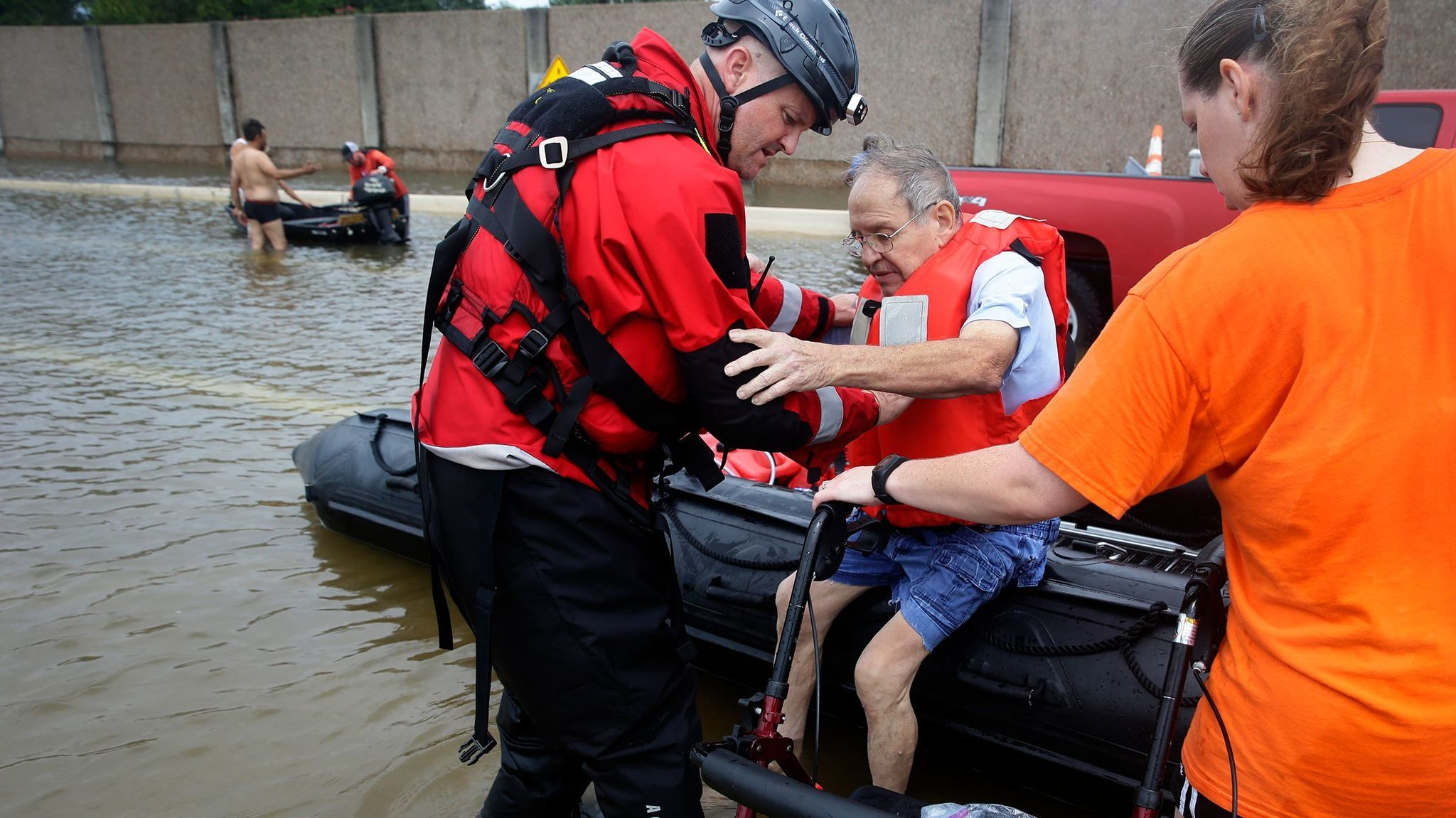 A Houston Police Department officer helps Frank Andrews, 74, into his walking chair after rescuing him from his flooded home in the Braeswood Place neighborhood southwest of Houston.