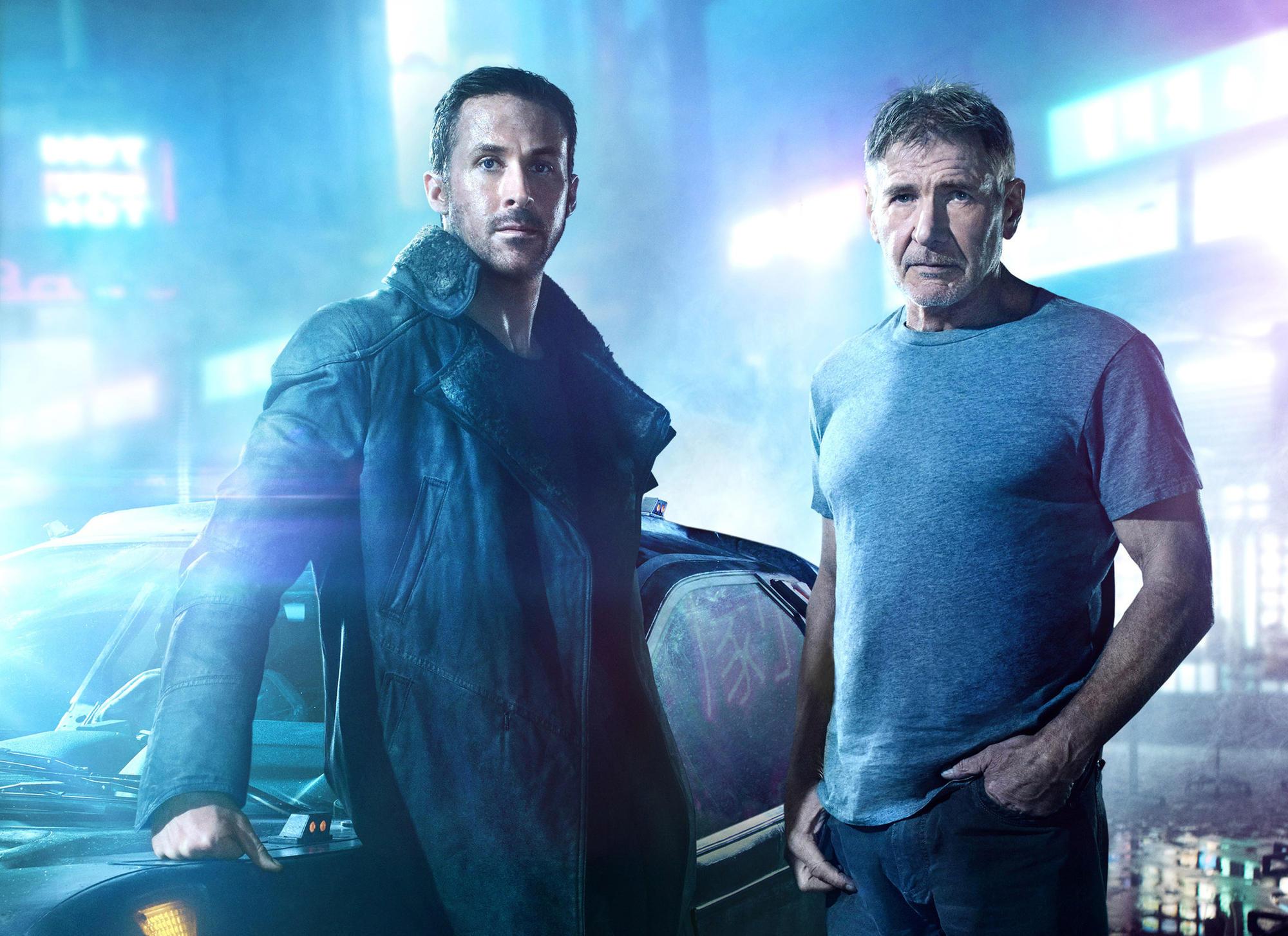 "Ryan Gosling, left, stars as Officer K and Harrison Ford returns as Rick Deckard in ""Blade Runner 2049."" (Frank W. Ockenfels / Warner Bros.)"