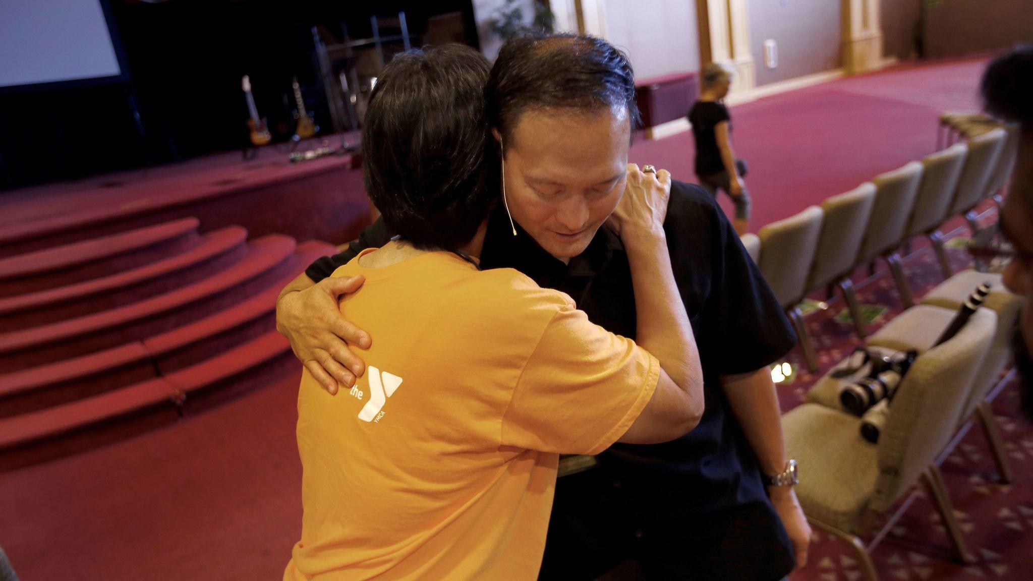 Hilda Tsang hugs Pastor Rocky Seto following Sunday morning service at Evergreen SGV Baptist Church.