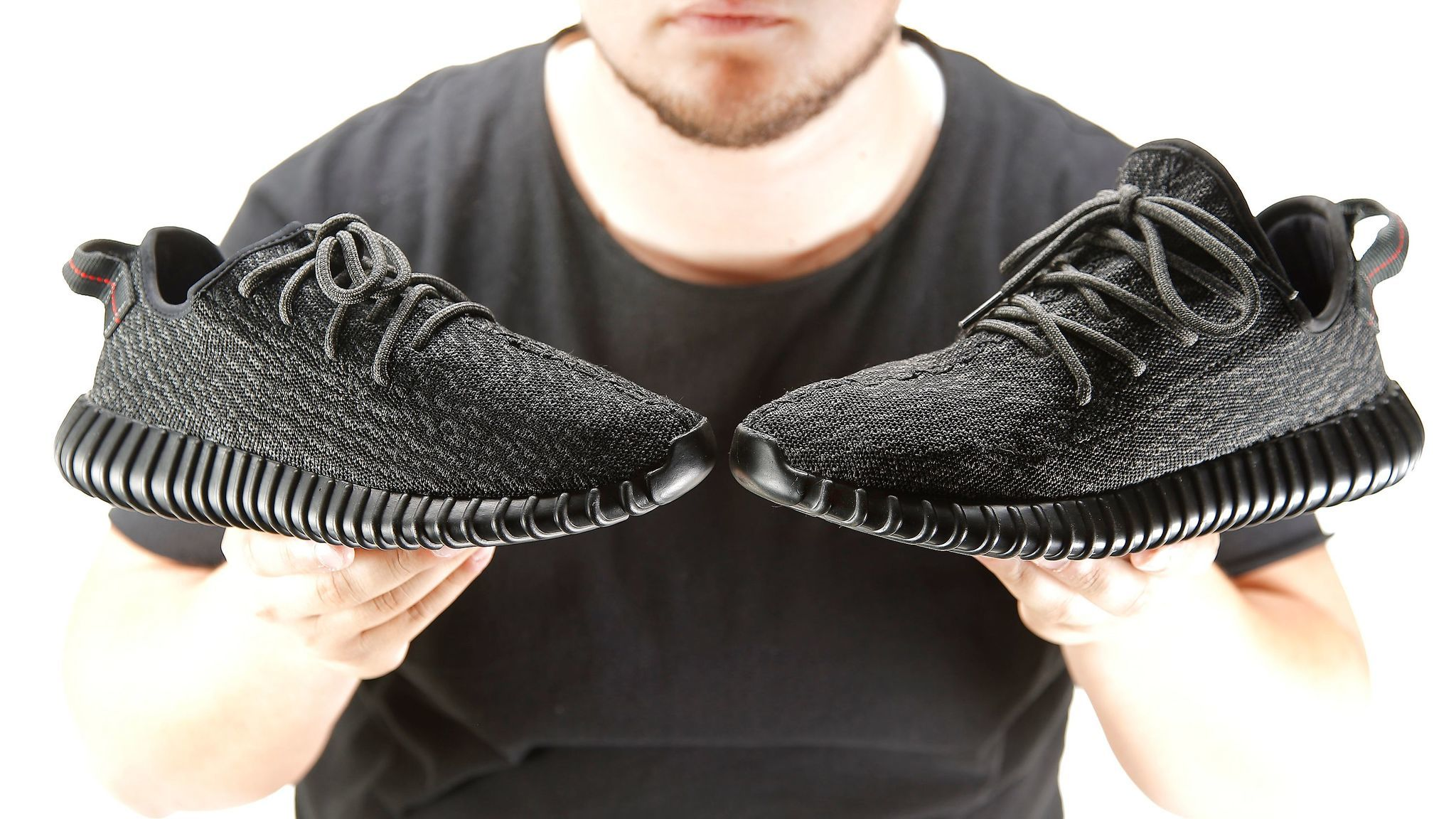 An authentic Yeezy, left, and a replica model owned by Kevin, right.