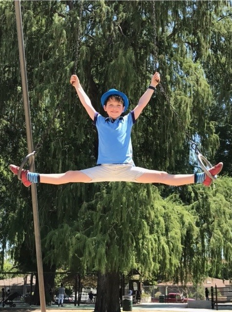Iain Armitage playing on the gymnastic rings at Beeman Park in Studio City.