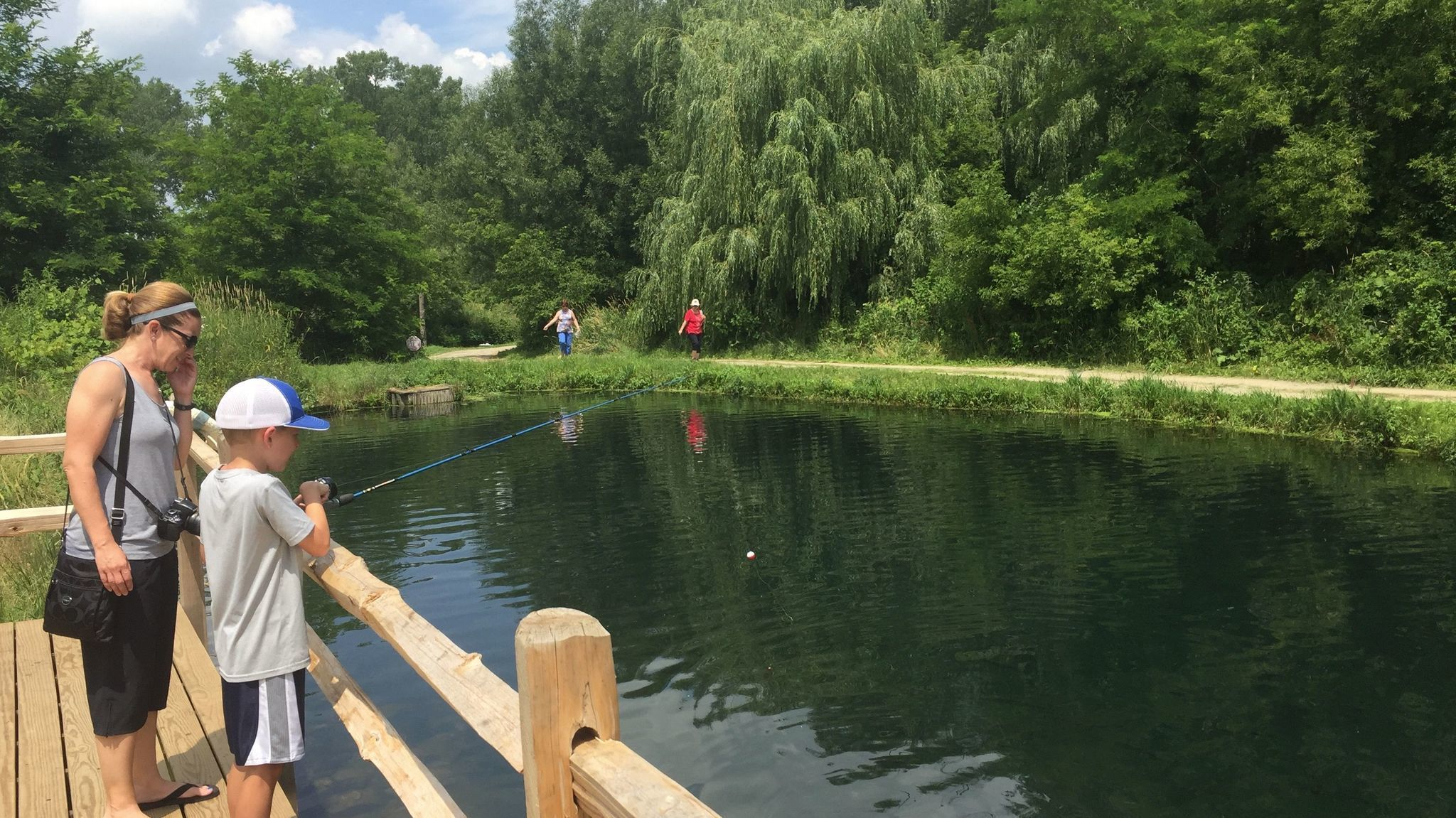 Fun fishing at wisconsin 39 s rushing waters trout farm no for Wisconsin fish farms