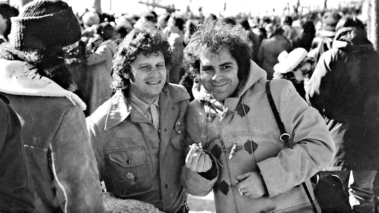 Jerry Rubin (right) and Paul Krassner share a joint in the late '60s. (Fantagraphics Books, Inc.)