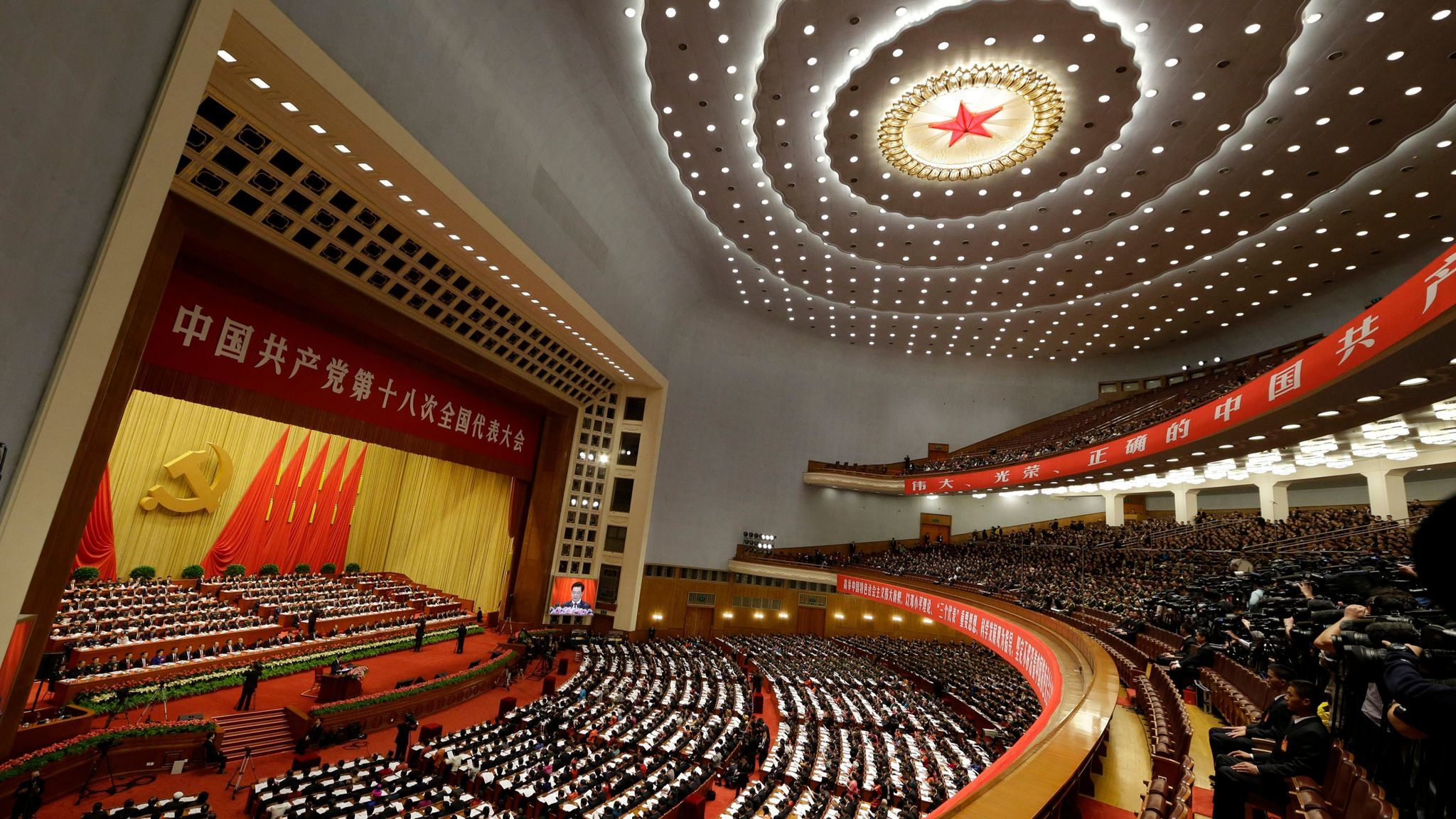 A 2012 file photo showing then-Chinese President Hu Jintao, center on the stage, at the 18th Communist Party congress held at the Great Hall of the People in Beijing.