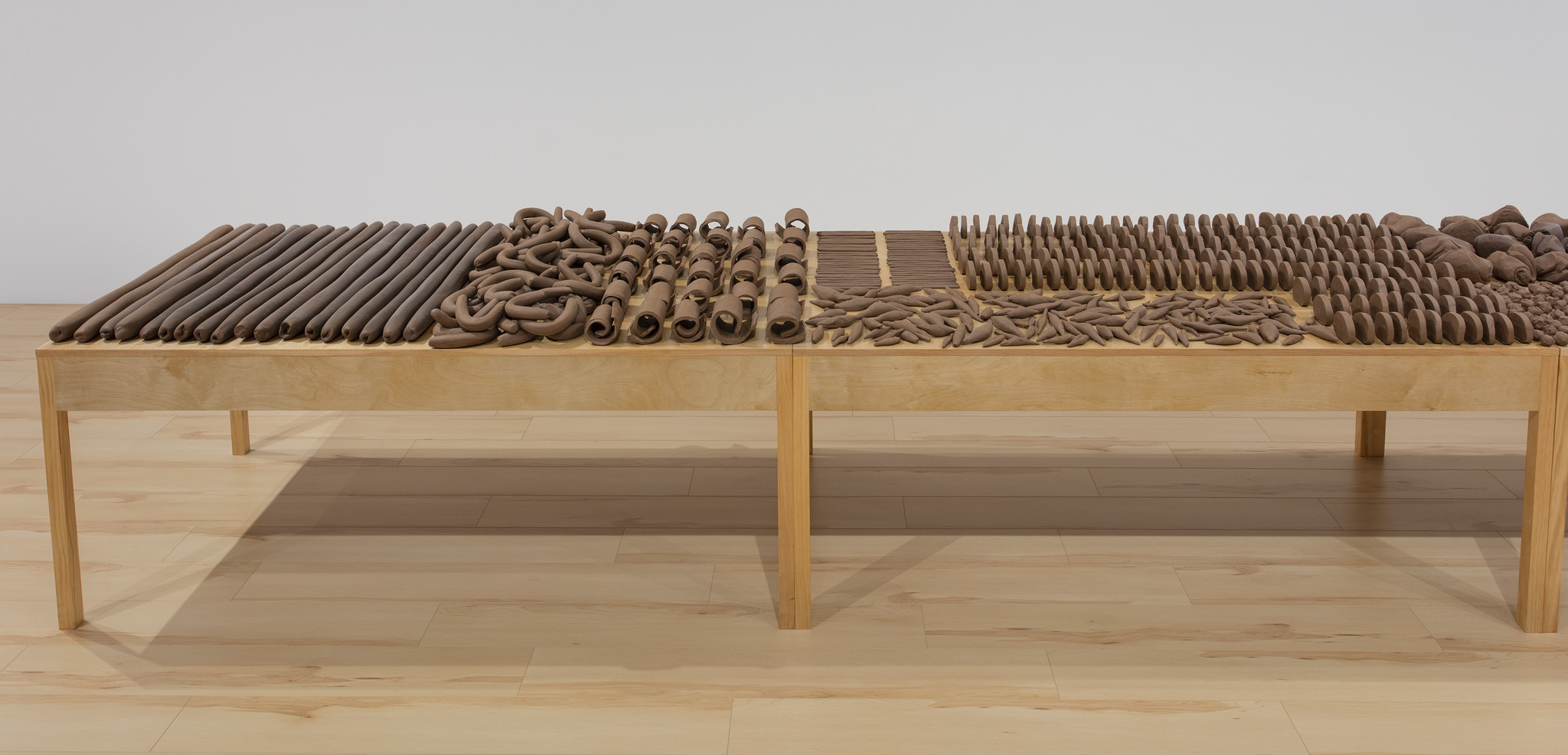 "Anna Maria Maiolino, ""Untitled Clay Table Installation (detail),"" 2017, raw clay and wood."