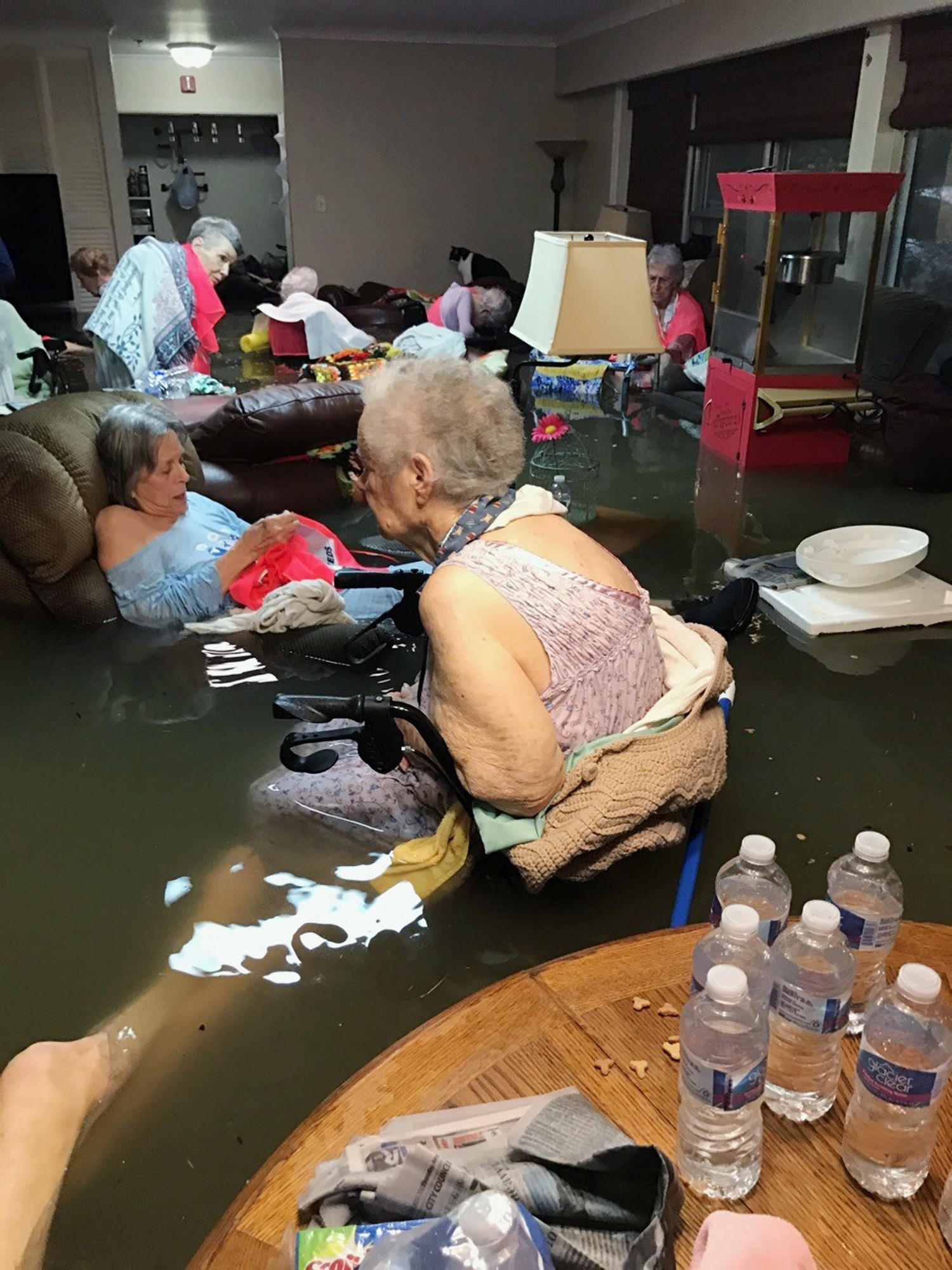 Residents of the La Vita Bella nursing home in Dickinson, Texas, sit in waist-deep floodwaters caused by Hurricane Harvey.
