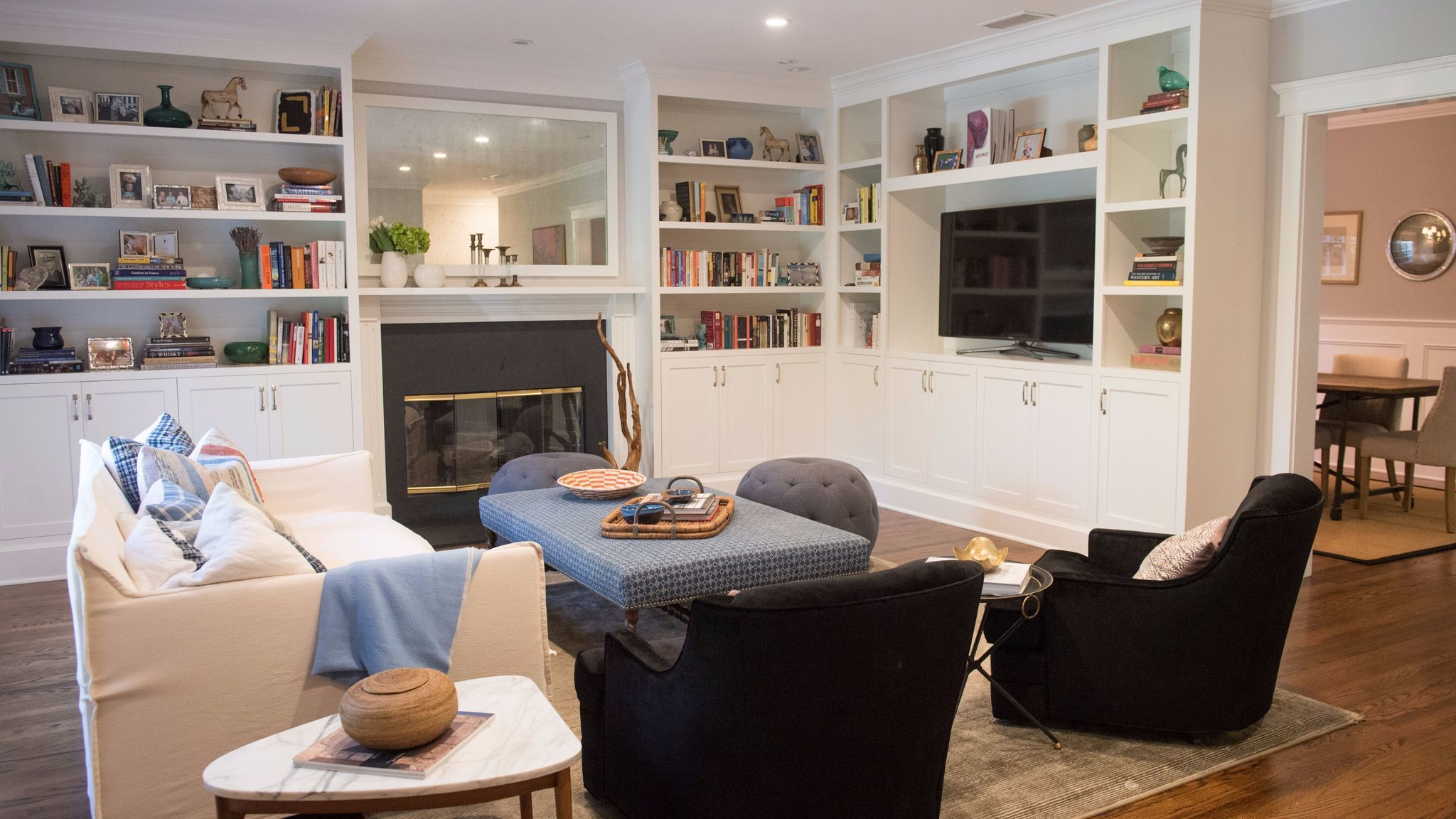 After: Built-in bookshelves and storage greatly improved the appearance of the living room.