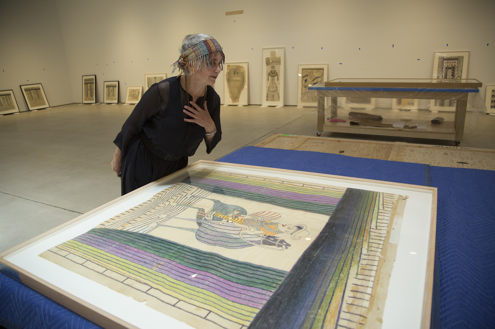 Elsa Longhauser looking at one of the works by Martín Ramírez.