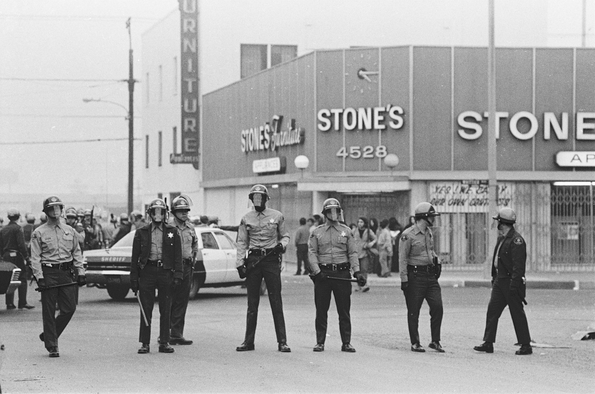 """L.A. County Sheriff's deputies assemble at the Marcha por la Justicia (March for Justice) in 1971, from """"La Raza"""" at the Autry Museum."""