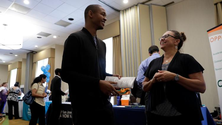 Big 5 Sporting Goods recruiter Kathy Tringali talks to applicant Jarrell Palmer at a job fair in San Jose. (Marcio Jose Sanchez / Associated Press)