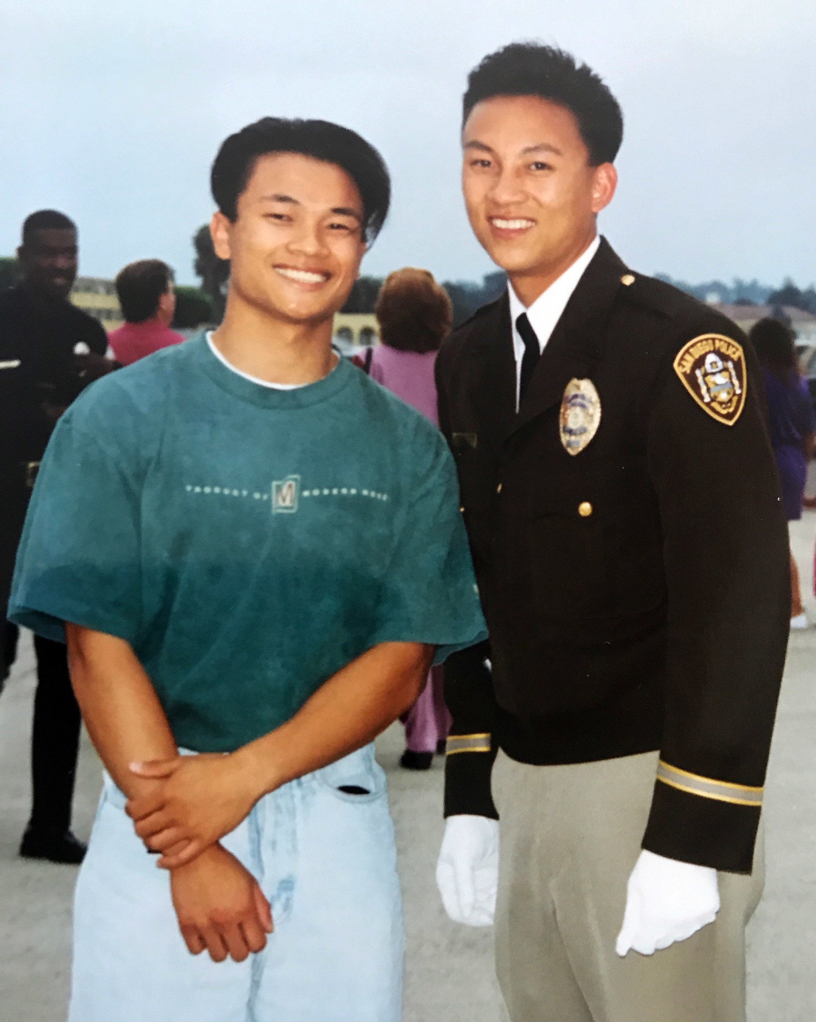 Timothy Vu, right, pictured with his brother, Tom, after graduating from the police academy in San Diego in 1993 at age 23.
