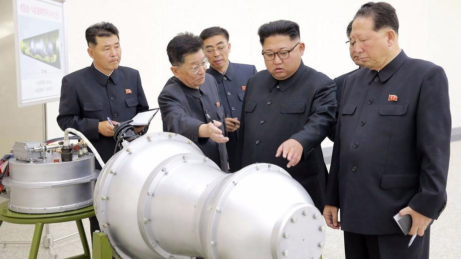 Kim Jong Un, center, examines a device at an undisclosed location in an undated photo released by North Korea's official news agency. — Photograph: Agence France-Presse/Getty Images.