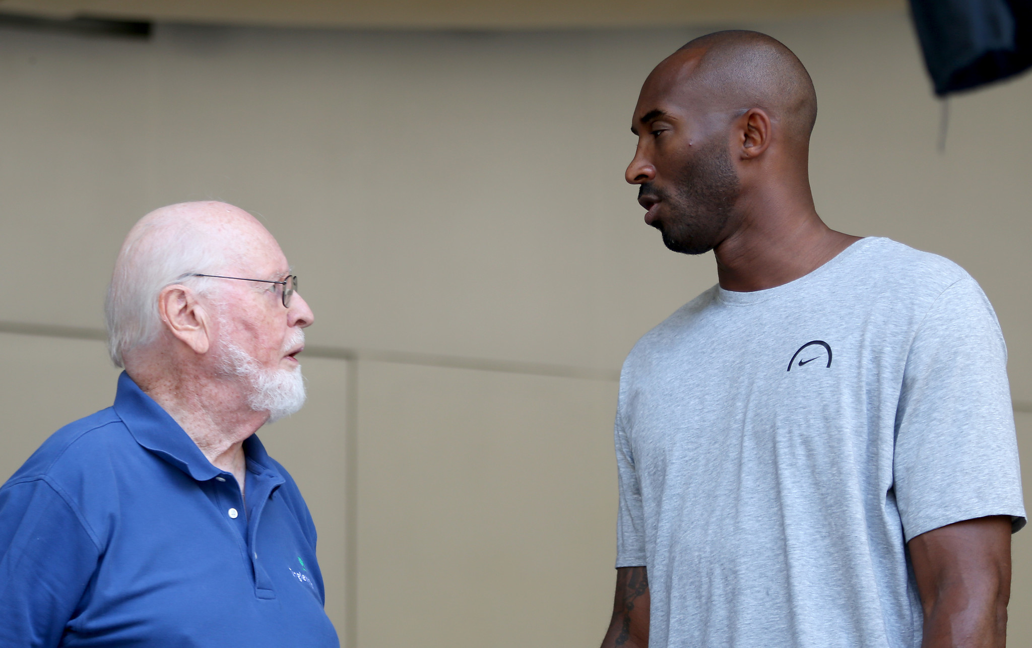 John Williams, left, and Kobe Bryant conferring during rehearsals at the Bowl.