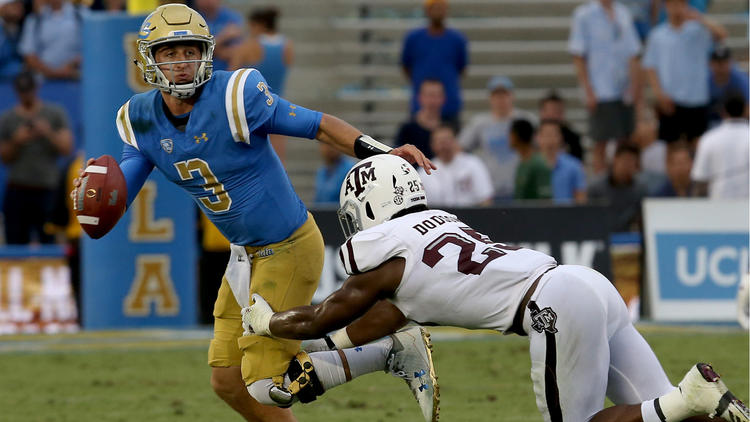 UCLA quarterback Josh Rosen tries to scramble away from the pressure of Texas A&M linebacker Tyler Dodson in the second quarter. (Luis Sinco / Los Angeles Times)
