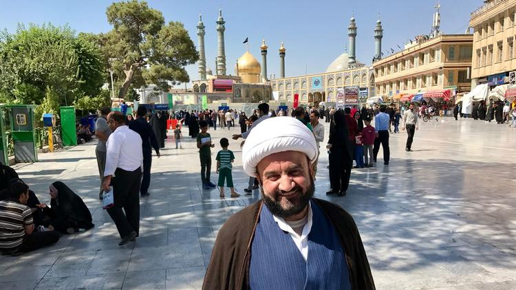Mohammad Ebadi, a Shiite cleric in Qom, stands in front of the shrine to Fatimah Masumeh, one of the