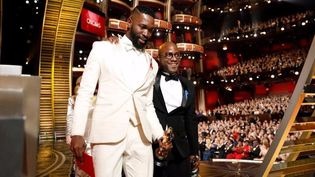 "Tarell Alvin McCraney, left, and Barry Jenkins after accepting the 2016 Oscar for adapted screenplay for ""Moonlight."""