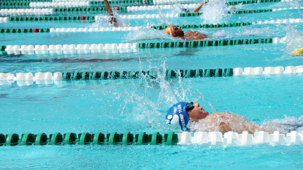 Dustin Walter competes in the 50-meter backstroke during the San Diego-Imperial Swimming Junior Olympic Long Court Swimming Championships in Coronado.