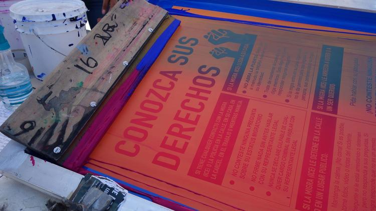 At Self-Help Graphics, artists silkscreen posters that provide tips on dealing with ICE agents.