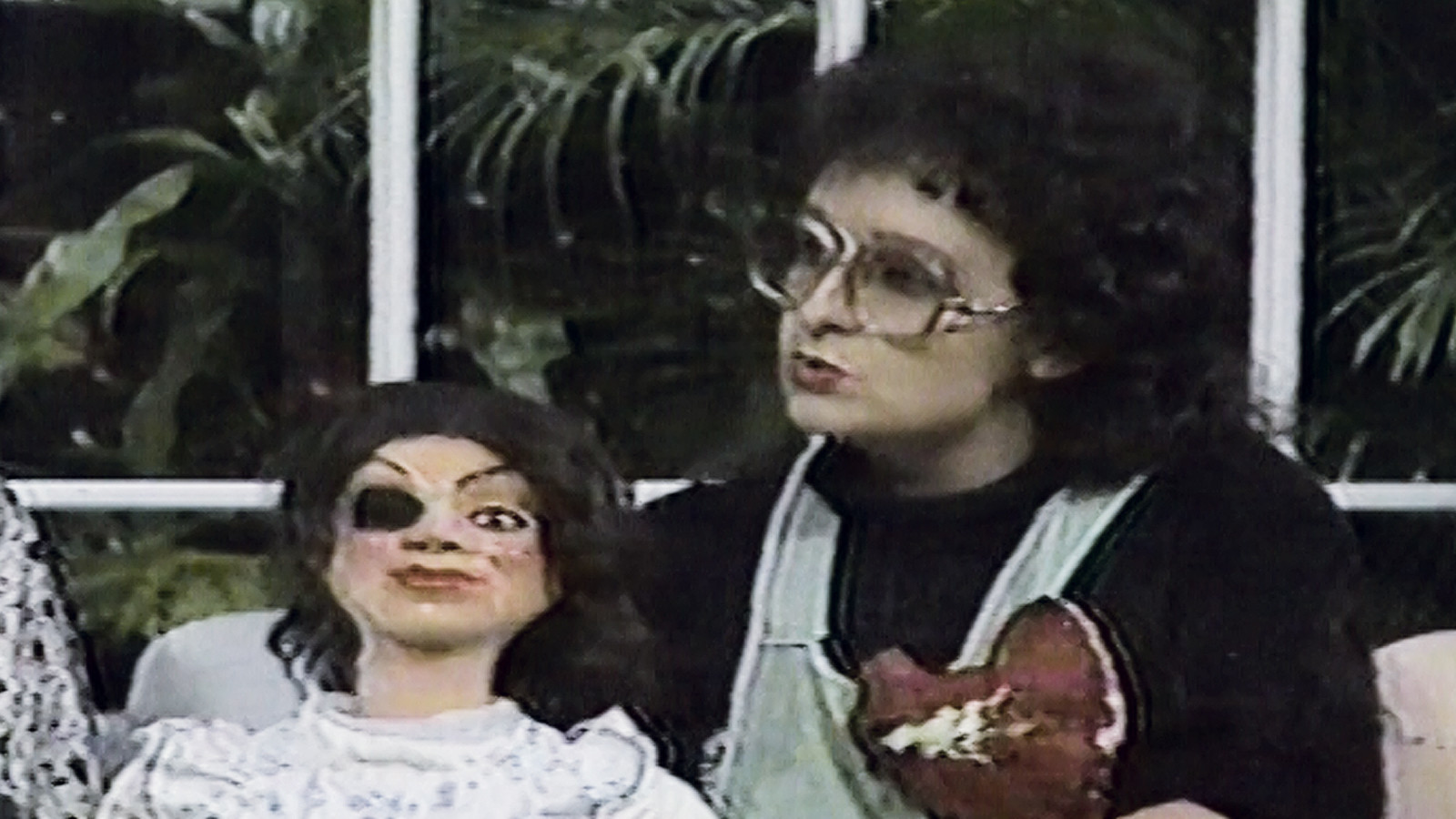 "A video still shows  Mónica Mayer on the television show hosted by Guillermo Ochoa as part of the performance ""Madre por un día"" (Mother for a day), from 1987. Mayer's work is part of ""Radical Women."""