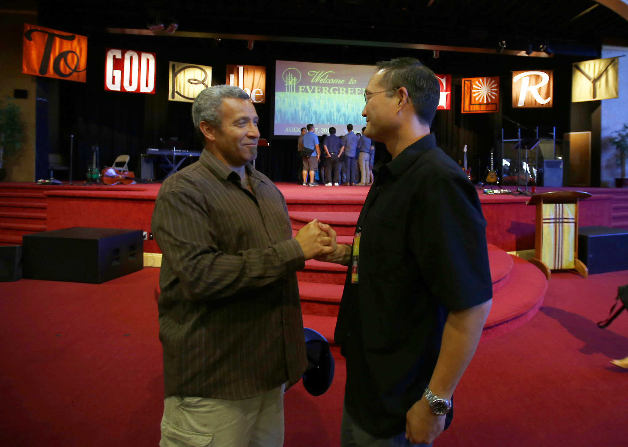 Sal Reynoso, 52, greets Pastor Rocky Seto following Sunday morning service at Evergreen SGV Baptist Church in La Puente.