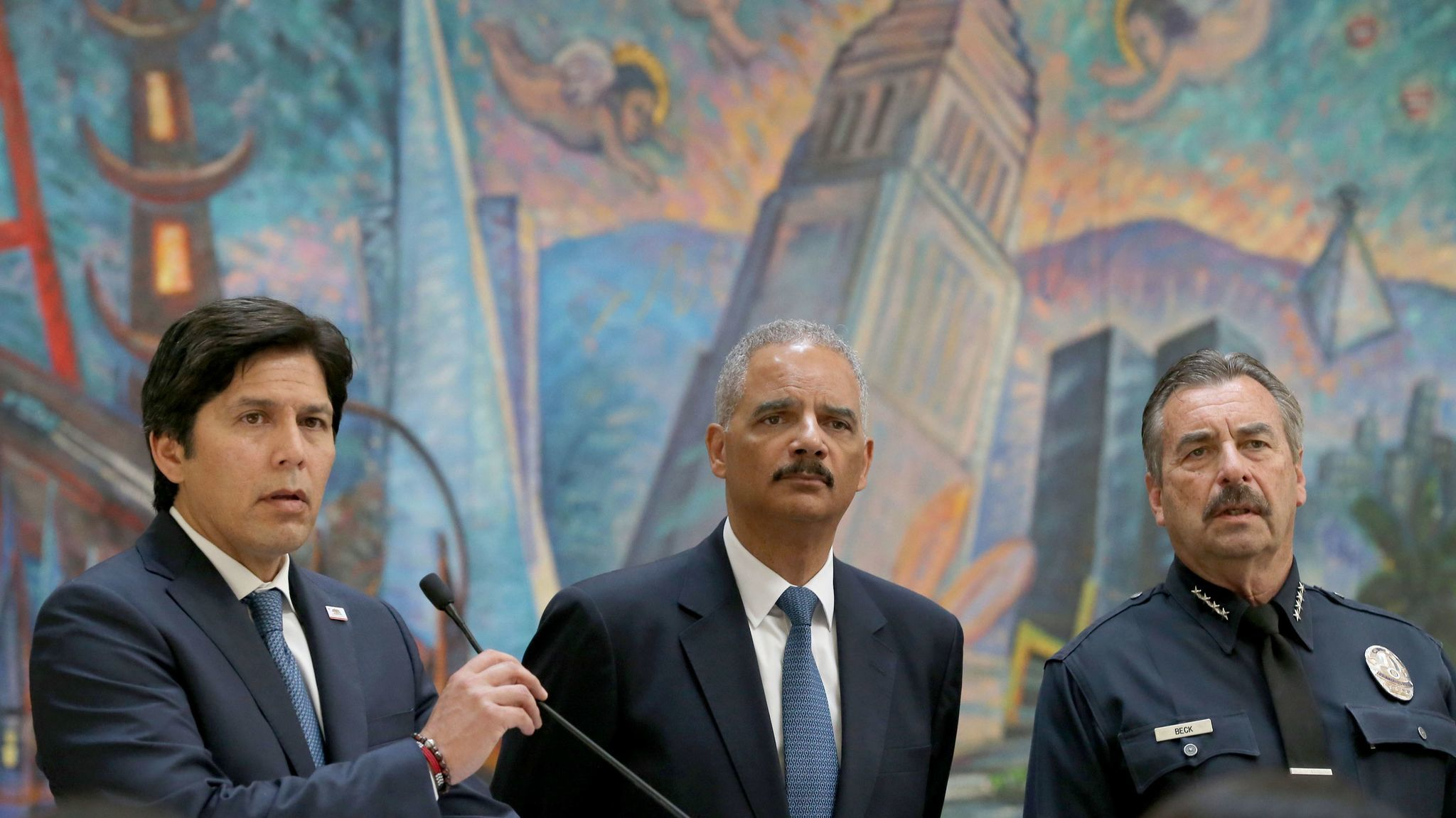 Senate leader Kevin de León, left, answers questions during a news conference to address the so-called sanctuary state bill while Former U.S. Atty. Gen. Eric Holder, center, and LAPD Chief Charlie Beck listen.