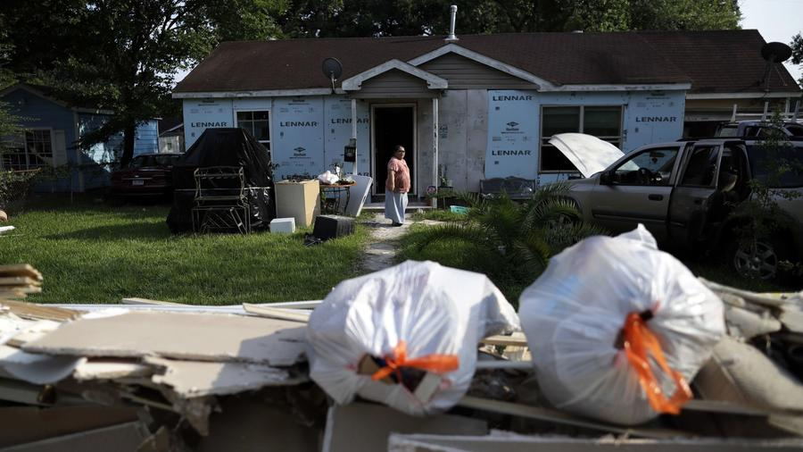 Cleanup after Hurricane Harvey in Houston.Griselda Perez looks out from behind a wall of flood-damaged d