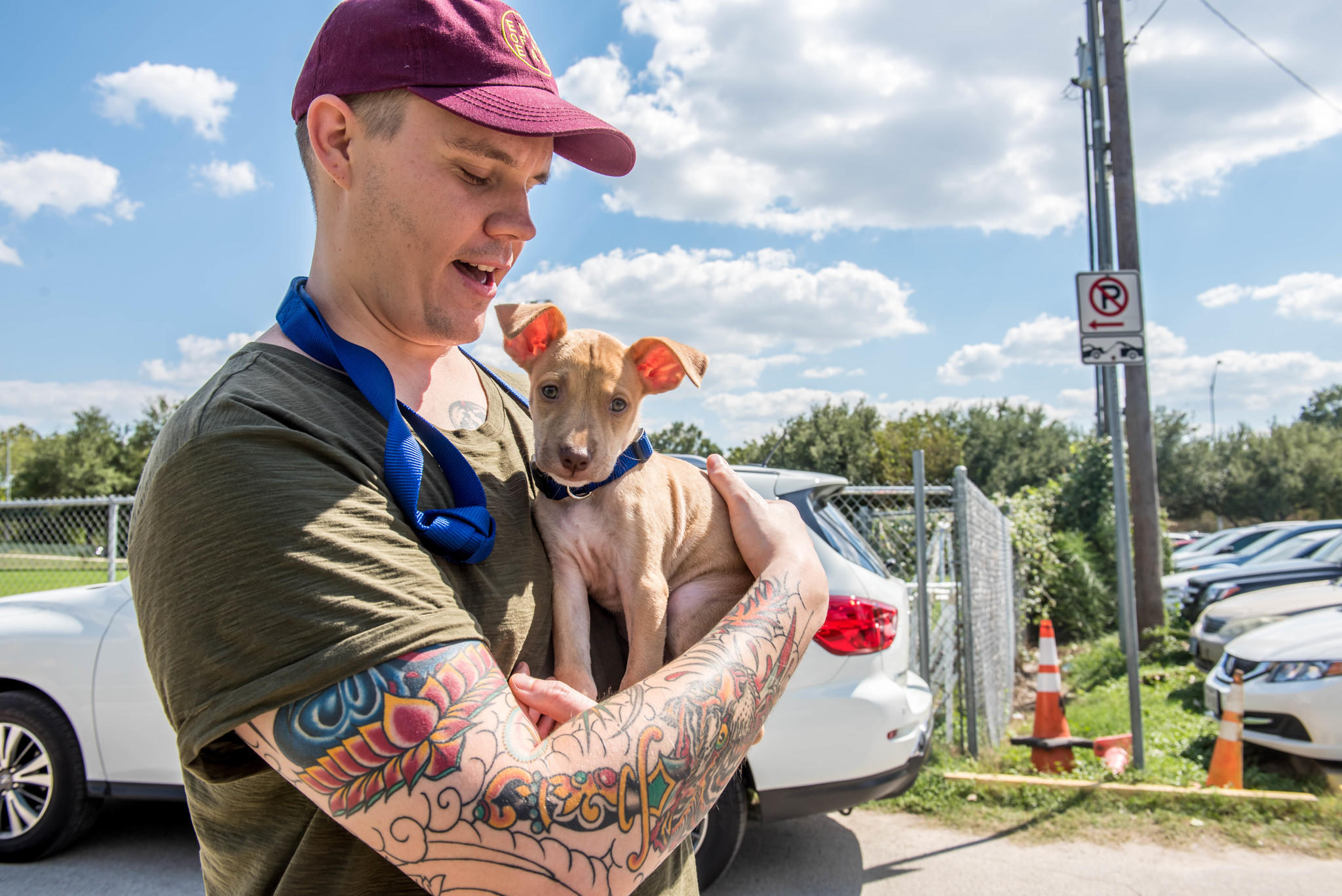 "A man holds a rescued puppy on Animal Planet's ""Surviving Harvey: Animals After the Storm."" (Discovery Communications)"