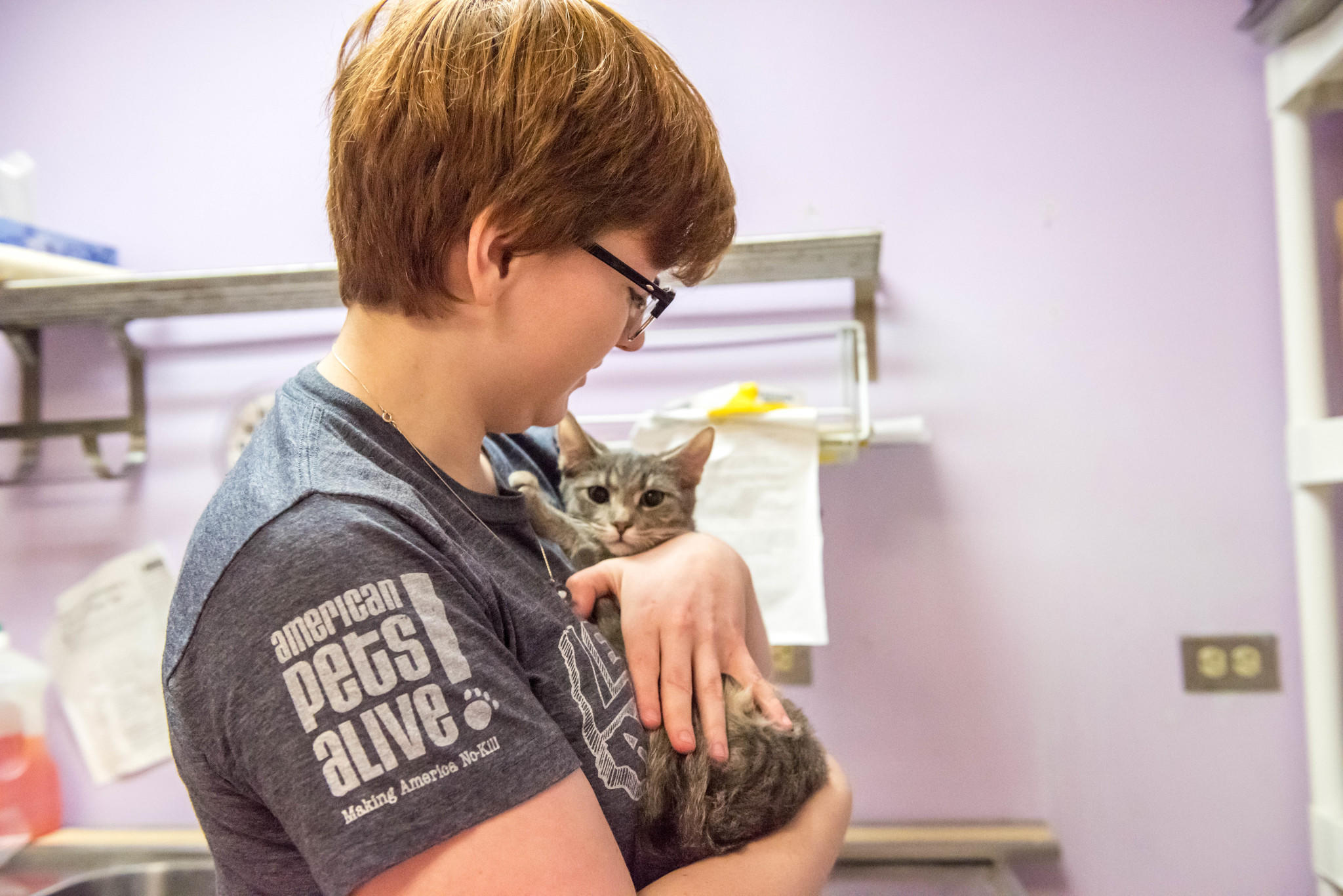 "A woman cradles a kitten rescued from Texas' floods on Animal Planet's ""Surviving Harvey: Animals After the Storm."" (Discovery Communications)"
