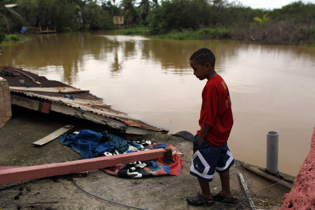 A boy looks on in the aftermath of Hurricane Irma in Fajardo, Puerto Rico, on September 7, 2017.