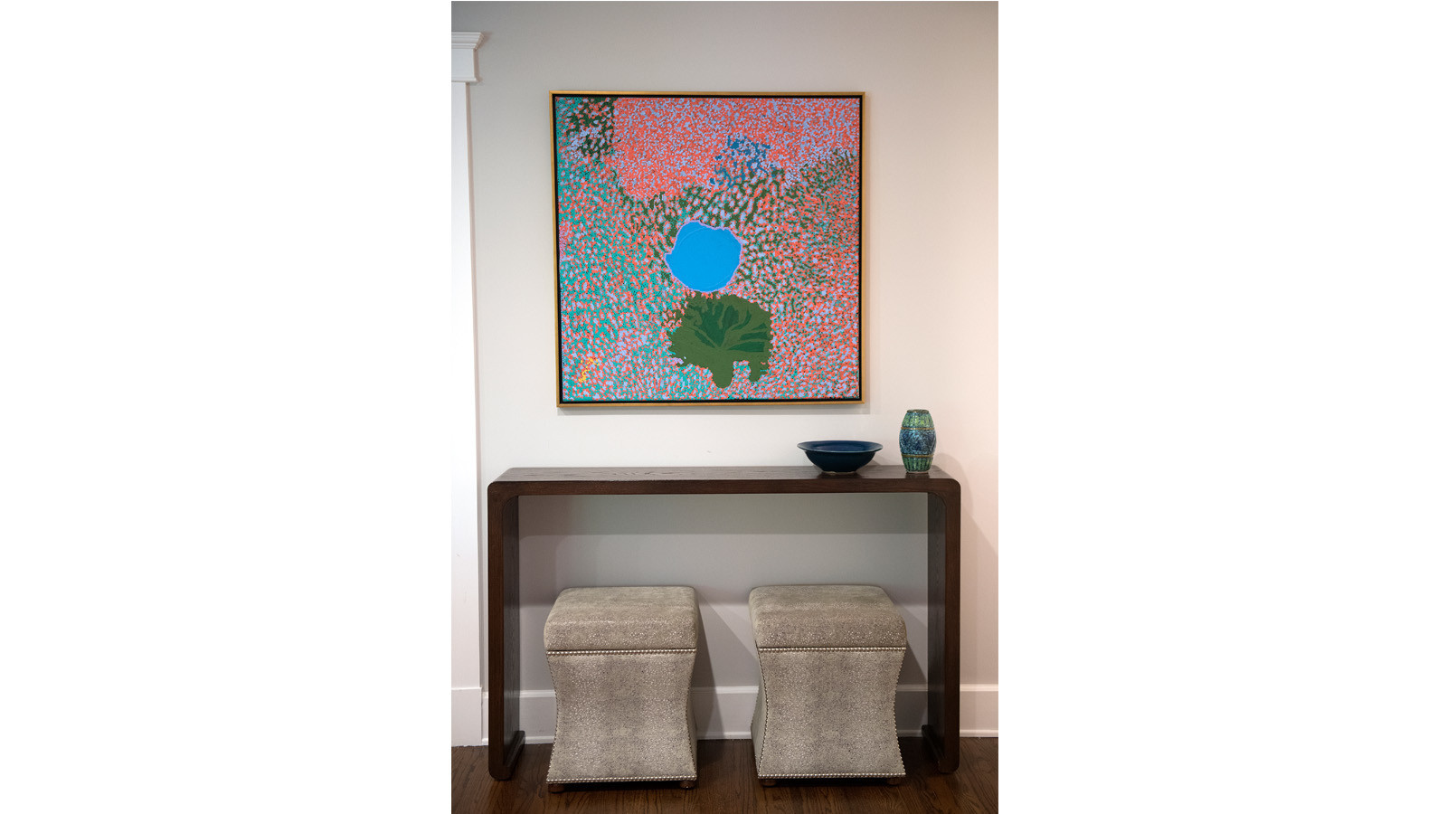 A colorful Aboriginal painting hangs in the living room.